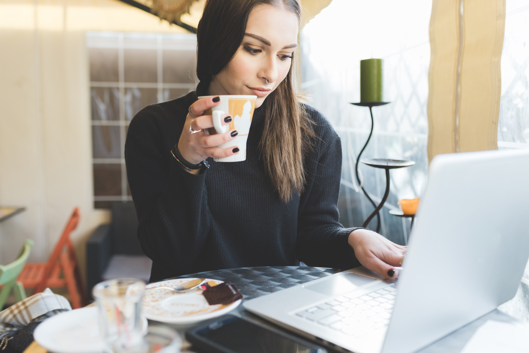 graphicstock-young-handsome-caucasian-woman-sitting-in-a-bar-working-with-her-laptop-drinking-from-a-cup-looking-the-screen-business-technology-happiness-concept_S6vt46Kyb (2)
